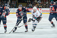 KELOWNA, CANADA - MARCH 26: Calvin Thurkauf #27 of Kelowna Rockets checks Deven Sideroff #34 of Kamloops Blazers on March 26, 2016 at Prospera Place in Kelowna, British Columbia, Canada.  (Photo by Marissa Baecker/Shoot the Breeze)  *** Local Caption *** Calvin Thurkauf; Deven Sideroff;