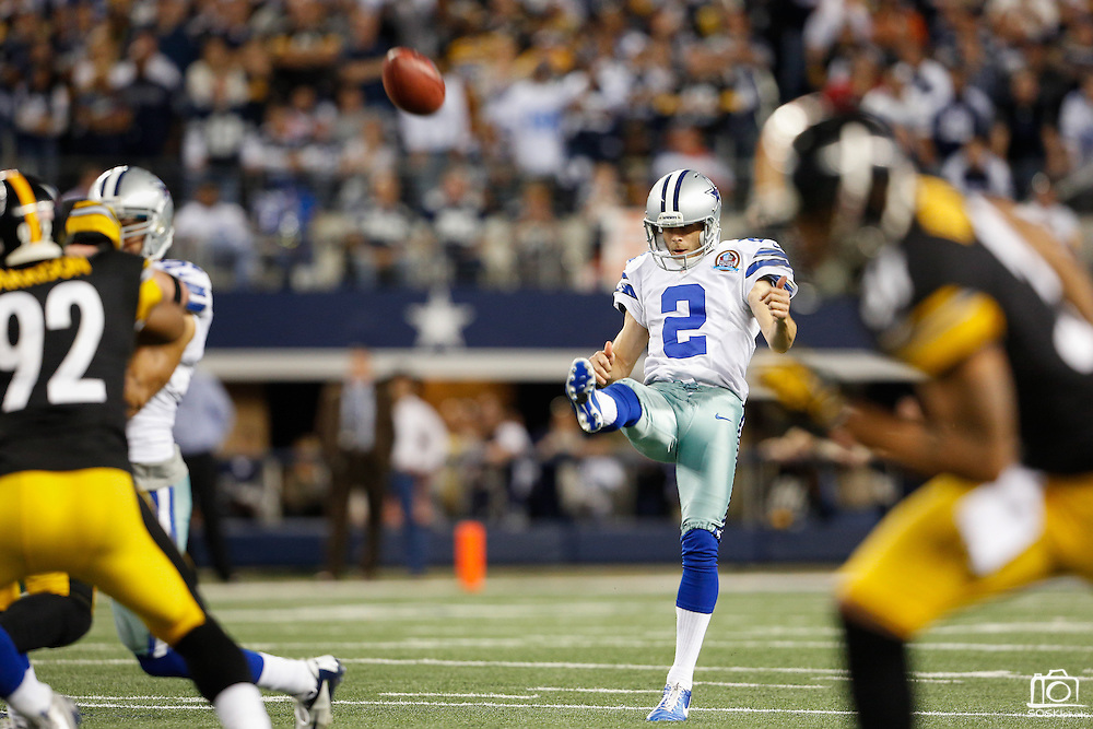 Dallas Cowboys punter Brian Moorman (2) punts the ball late in the fourth quarter against Pittsburgh Steelers at Cowboys Stadium in Arlington, Texas, on December 16, 2012.  (Stan Olszewski/The Dallas Morning News)