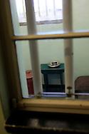 Nelson Mandella's cell on Robben Island The island where Nelson Mandella was held prisoner near Cape Town, South Africa.  Photo by Dennis Brack...