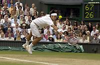 Tennis<br /> Wimbledon 2005<br /> Foto: Colorsport/Digitalsport<br /> NORWAY ONLY<br /> <br /> Roger Federer (Sui). Mens singles Final. Roddick v Federer. 3/7/2005. Centre Court. Wimbledon Tennis Championships 2005.