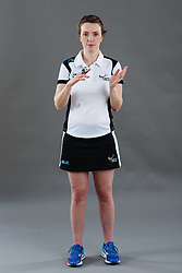 Umpire Louise Travis signalling incorrect playing the ball