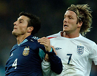 Photo: Glyn Thomas.<br />England v Argentina. International Friendly. 12/11/2005.<br />England's David Beckham (R) clashes with Javier Zanetti.