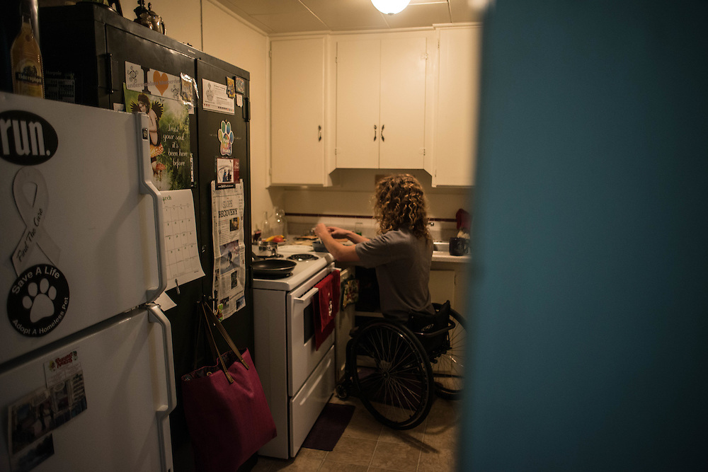 Ravi prepares breakfast. A newspaper article from the Bend Bulletin profiling his athletic achievements hangs on Clover's refrigerator.