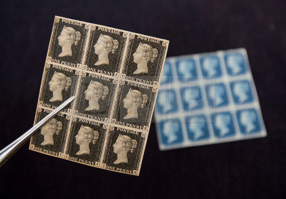 © Licensed to London News Pictures. 01/09/2011. London, UK. A  mint block of 1840 1d plate 4 Penny Black stamps (left) and a block of 12 1840 2d Penny Blue stamps (right)  estimated to fetch £130,000 to £150,000 and £80,000 to £120,000 respectively at a Sotheby's sale of The Philatelic Collection of Lord Steinberg on September 6-8 2011. The whole collection is expected to fetch in the region of £4 million. Photo credit: Ben Cawthra/LNP