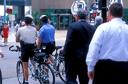 Stock photo of two bicycle police at a street crossing in downtown Houston Texas