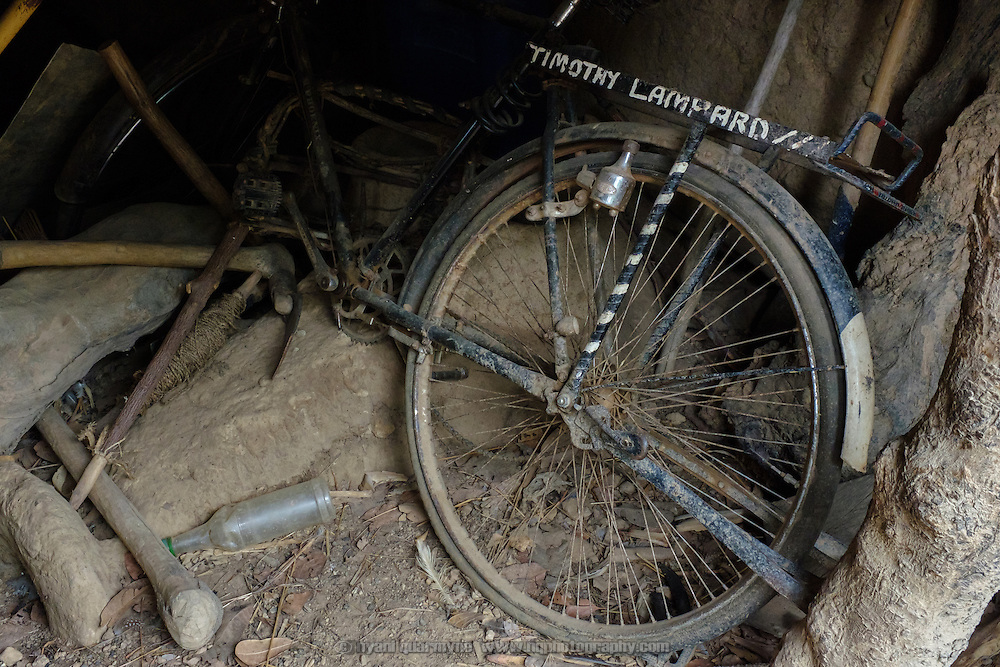"""The name """"Timothy Lampard"""" painted on a broken down bicycle at a homestead in the village of Kangpuo in the Upper West region of Ghana on 25 June 2015."""