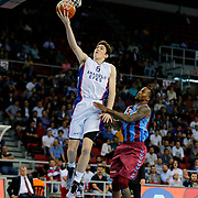 Anadolu Efes's Cedi Osman (L) and Trabzonspor's Demarquis D'Angelo Bost (R) during their Turkish Basketball League Play Off Semi Final round 1 match Anadolu Efes between Trabzonspor at Abdi Ipekci Arena in Istanbul Turkey on Friday 29 May 2015. Photo by Aykut AKICI/TURKPIX