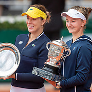 PARIS, FRANCE June 12. Winner Barbora Krejcikova (right) of the Czech Republic and runner up Anastasia Pavlyuchenkova of Russia with their trophies after the presentation on Court Philippe-Chatrier after the final of the singles competition at the 2021 French Open Tennis Tournament at Roland Garros on June 12th 2021 in Paris, France. (Photo by Tim Clayton/Corbis via Getty Images)