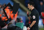 Referee Andy Madley checks the pitch side screen while a VAR review is in progress for a red card initially shown to Crystal Palace's Joel Ward which is then changed to a yellow card during the Premier League match at Selhurst Park, London. Picture date: 1st February 2020. Picture credit should read: Paul Terry/Sportimage