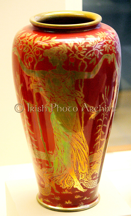 Earthenware Vase with gold lustre design. Depicting daughters of Hesperus guarding the golden apples from classical Greek mythology. Designed by Walter Crane in England in 1906 AD.