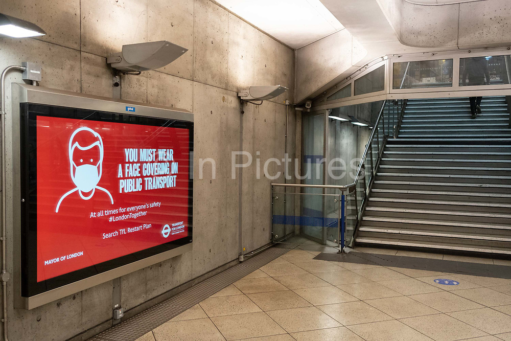 The day after the government introduced a third Coronavirus pandemic national lockdown, effectively a Tier 5 restriction, face coverings remain mandatory on public transport and underground stations such as Westminster, as the capital experiences a grim post-Christmas and millions of Britons are told to stay at home, on 5th January 2021, in London, England.