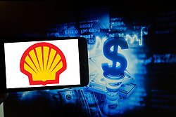 March 22, 2019 - Amsterdam, North Holland, Netherlands - The logo of Royal Dutch Shell is seen on a screen next to an illustration of the stock market. It is part of the Amsterdam Exchange Index ( AEX 25  (Credit Image: © Alexander Pohl/NurPhoto via ZUMA Press)