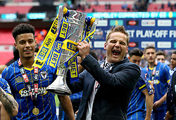 AFC Wimbledon Manager Neal Ardley celebrates promotion to League One with the League Two Playoff Trophy - Mandatory by-line: Robbie Stephenson/JMP - 30/05/2016 - FOOTBALL - Wembley Stadium - London, England - AFC Wimbledon v Plymouth Argyle - Sky Bet League Two Play-off Final