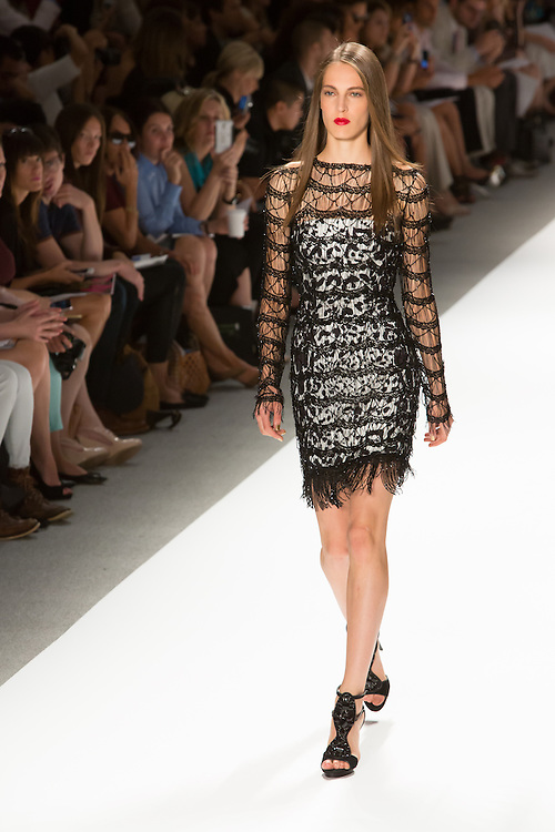 White  and black print dress with beaded netting overlay. By Carlos Miele at the Spring 2013 Mercedes-Benz Fashion Week in New York.