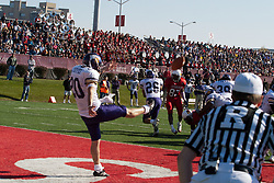 29 October 2005: Kris Coffee serves up a punt from the endzone to get the Leathernecks out of trouble. With a final score of 31 - 17, Western Illinois University Leathernecks collared the Illinois State University Redbirds knocking them from their 18th ranked perch at Hancock Field on Illinois State's campus in Normal IL