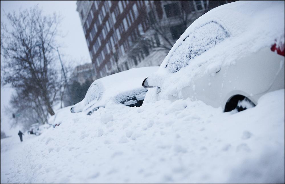 Major snow storm buries cars in Midtown Kansas City, MO.