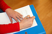 a female hand Signing a contract aka model release