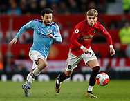 Brandon Williams of Manchester United tussles with Bernardo Silva of Manchester City during the Premier League match at Old Trafford, Manchester. Picture date: 8th March 2020. Picture credit should read: Darren Staples/Sportimage