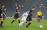 Real Madrid's Michael Owen is out numbered by Roma's Traianos Dellas and rest of the Roma defence as he tries to attack