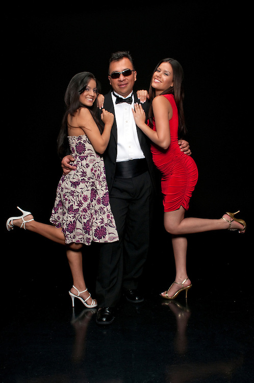 40 something executive with tuxedo flirting with young girls.
