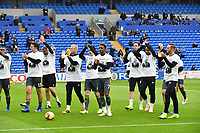 Football - 2018 / 2019 Premier League - Cardiff City vs. Leicester City<br /> <br /> Leicester fans/players with tributes to Vichai Srivaddhanaprabha in Leicster's 1st match since the death of Vichai Srivaddhanaprabha, at Cardiff City Stadium.<br /> <br /> COLORSPORT/WINSTON BYNORTH