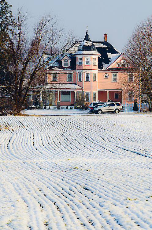 A rural home in southern New Jersey glows in the winter's early morning sun.
