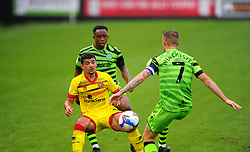 Josh Gordon of Walsall is challenged by Carl Winchester of Forest Green Rovers- Mandatory by-line: Nizaam Jones/JMP - 03/10/2020 - FOOTBALL - the innocent [insert name here] stadium - Nailsworth, England - Forest Green Rovers v Walsall - Sky Bet League Two