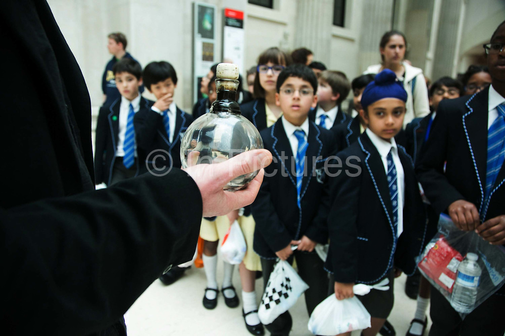 """The art activist protest group Bp-or-not-Bp make an artistic intervention at the British Museum to highlight the fact that the oil company BP sponsors a show called Sunken Cities at the Museum May 17 2016. (photo by Kristian Buus/In Pictures via Getty Images) School children visiting the museum learn about the implications of BP's sponsorship and get to see the crude oil from the Mixican Guld oil dissaster. The press release states:  """"The lines of stones in the artwork represent the 340 people forcibly disappeared in the four months prior to BP signing a $12bn dollar deal with the Sisi regime – a rehash of a deal it had made with the Mubarak regime. The total number disappeared under the Sisi regime may run into thousands. [3] Teargas is a weapon that was used both to repress popular protest in Tahrir Square during the revolution but also those who actively opposed BP's operations in the country. """""""