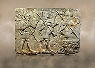 Photo of Hittite monumental relief sculpted orthostat stone panel from the Herald's Wall. Basalt, Karkamıs, (Kargamıs), Carchemish (Karkemish), 900-700 B.C. Military parade. Anatolian Civilisations Museum, Ankara, Turkey. Two helmeted soldiers in short skirts carry the shield on their backs and the spears in their hands.  <br /> <br /> Against a brown art background. .<br /> <br /> If you prefer to buy from our ALAMY STOCK LIBRARY page at https://www.alamy.com/portfolio/paul-williams-funkystock/hittite-art-antiquities.html  - Type  Karkamıs in LOWER SEARCH WITHIN GALLERY box. Refine search by adding background colour, place, museum etc.<br /> <br /> Visit our HITTITE PHOTO COLLECTIONS for more photos to download or buy as wall art prints https://funkystock.photoshelter.com/gallery-collection/The-Hittites-Art-Artefacts-Antiquities-Historic-Sites-Pictures-Images-of/C0000NUBSMhSc3Oo
