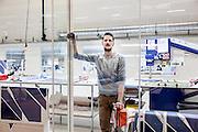 Lyon, Atelier Hermès, Wilfried cutting the silk for man ties.