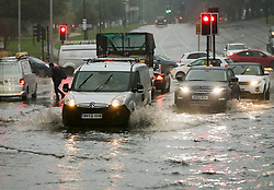 © Licensed to London News Pictures. 03/10/2020. London, UK.  A van and cars drive through a flood in north London caused by Storm Alex. The Met Office forecasts heavy rain and windy weather for the rest of the day in the capital. Photo credit: Dinendra Haria/LNP