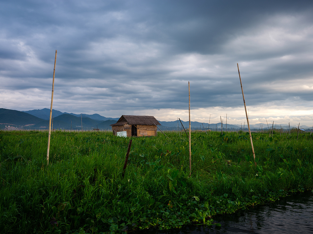 INLE LAKE, MYANMAR - CIRCA DECEMBER 2017: Typical shack on stilts and floating islands in Inle Lake, Myanmar