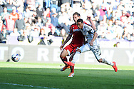 Swansea city's Jonathan De Guzman shoots just wide of goal. Barclays Premier league match, Swansea city v West Bromwich Albion at the Liberty Stadium in Swansea, South Wales on Saturday 15th March 2014. pic by Andrew Orchard,  Andrew Orchard sports photography.