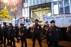 © Licensed to London News Pictures. 09/11/2016. New York, USA. Police officers protect Trump Tower as thousands of anti-Trump protesters march from Union Square to Trump Tower in New York City, on Wednesday, 9 November 2016 following the presidential election won by Donald Trump. Photo credit: Tolga Akmen/LNP