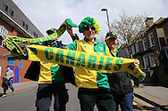Group of Norwich City fans pose and chant outside Selhurst Park before k/o. Barclays Premier League match, Crystal Palace v Norwich city at Selhurst Park in London on Saturday 9th April 2016. pic by John Patrick Fletcher, Andrew Orchard sports photography.