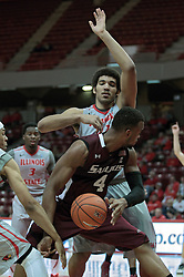 05 January 2014:  Davante Drinkard works hard to get past Zach Lofton and Reggie Lynch during an NCAA  mens basketball game between the Salukis of Southern Illinois and the Illinois State Redbirds  in Redbird Arena, Normal IL.  Final score ISU 66, SIU 48