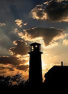 Sunbeams shine forth arround Chatham Light