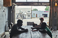 Refugee children play games at Refuge Coffee, the unofficial town square in Clarkston, GA. Part of a documentary series on Clarkston, GA.  The most ethnically diverse square mile in America, there are over 70 nationalities that have sought refuge there since the 1980s.