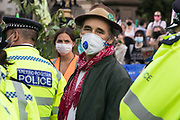 Actor Mark Rylance wears a mask to help prevent the spread of COVID-19 as he observes Metropolitan Police officers arresting climate activists from Extinction Rebellion who had occupied roads around Parliament Square during a Back The Bill rally on 1st September 2020 in London, United Kingdom. Extinction Rebellion activists are attending a series of September Rebellion protests around the UK to call on politicians to back the Climate and Ecological Emergency Bill (CEE Bill) which requires, among other measures, a serious plan to deal with the UK's share of emissions and to halt critical rises in global temperatures and for ordinary people to be involved in future environmental planning by means of a Citizens' Assembly.