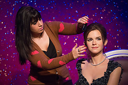 © licensed to London News Pictures. London, UK 26/03/2013. Madame Tussauds London reveals a new wax figure of Emma Watson on Tuesday 26 March 2013. Hair assistant Caryn Bloom adding the last touches to figure's hair. Photo credit: Tolga Akmen/LNP