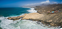 Aerial panaromic view of waves crashing of the rocks of punta Guadalupe in Fuerteventura, Canary Island.