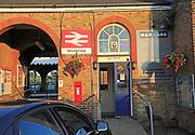 British Rail double arrow logo sign taxi office, railway train station, Woodbridge, Suffolk, England, UK