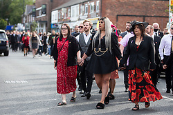© Licensed to London News Pictures. 18/09/2020. Manchester, UK. People line the streets of Urmston, Manchester to pay their respects at the funeral of 32 year old soldier Corporal Dean Corbett, who served alongside Lee Rigby, who died in a terrorist attack in Woolwich, London, in 2013. Corbett's mother, Karen Hessing, has called for more support for returning soldiers after her son, Dean Corbett took his own life during lockdown. Photo credit: Kerry Elsworth/LNP