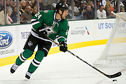 DALLAS, TX - OCTOBER 17:  Jordie Benn #24 of the Dallas Stars controls the puck against the San Jose Sharks on October 17, 2013 at the American Airlines Center in Dallas, Texas.  (Photo by Cooper Neill/Getty Images) *** Local Caption *** Jordie Benn