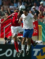 Guimaraes 14/6/2004 <br />Campionati Europei - European Championships 2004 <br />Danimarca Italia <br />mauro camoranesi e niclas jensen<br /><br />Photo Graffiti