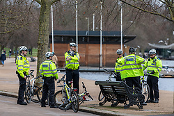 © Licensed to London News Pictures. 19/01/2021. London, UK. Police on bikes take a rest next to a bench in Hyde Park. Police keep up patrols in Hyde Park in London as Home Secretary Priti Patel warned that there will be tougher enforcement of Covid-19 rules. Today Health Secretary Matt Hancock announced that he will self-isolates after an alert on his Covid-19 app while cases continue to spread through the UK. Last week, Foreign Secretary Dominic Rabb said that lockdown could be lifted in March but with tier systems in place as total Covid-19 deaths reach over 88,000 this weekend. Photo credit: Alex Lentati/LNP