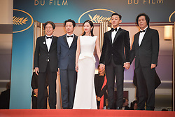 Steven Yeun, Jong-seo Jeon, Ah-in Yoo and Chang-dong Lee attending the premiere of the film Burning the 71st Cannes Film Festival in Cannes, France on May 16, 2018. Photo by Julien Zannoni/APS-Medias/ABACAPRESS.COM