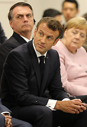 """Emmanuel Macron (French President) and Jair Bolsonaro (Brazil's President) - Side event organized by the Japanese Prime Minister, on the theme """"Promoting the place of women at work"""" at the Intex Osaka congress center at the G20 summit in Osaka, Japan, on June 29, 2019. Photo by Dominque Jacovides/Pool/ABACAPRESS.COM"""
