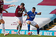 Erik Pieters of Burnley (23)  and Brighton and Hove Albion forward Neal Maupay (7) during the Premier League match between Burnley and Brighton and Hove Albion at Turf Moor, Burnley, England on 26 July 2020.