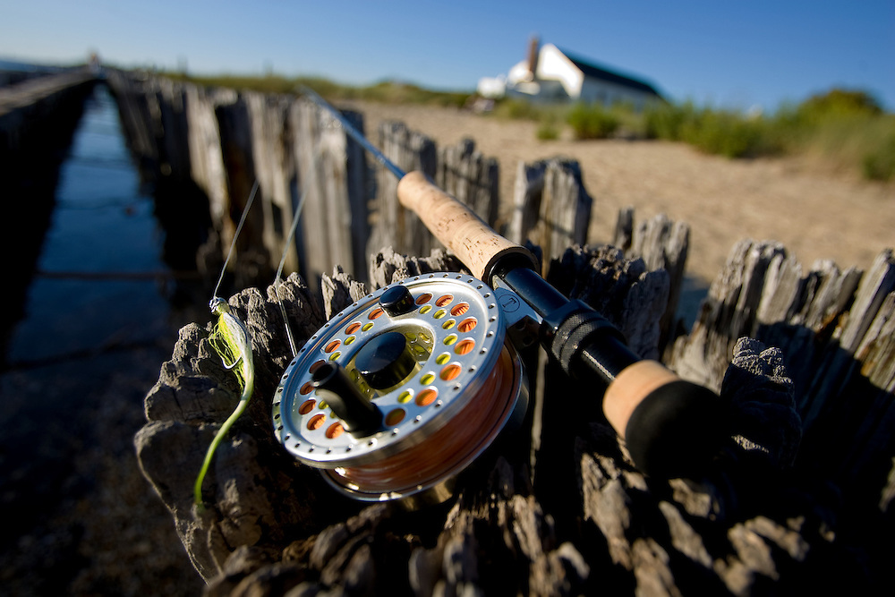 Flyrod, reel and fly on the wooden bulkhead at Sandy Hook National Park